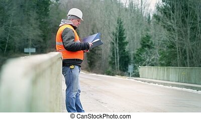 Engineer reading documentation on the bridge