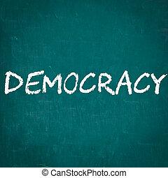 DEMOCRACY written on chalkboard