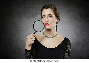 woman with magnifying glass - Attractive woman with...