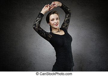 attractive woman with raised hands