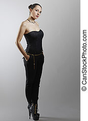 Fashionable woman in black jumpsuit
