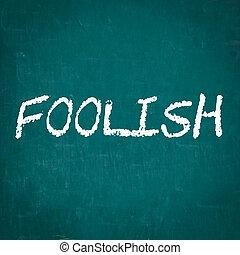 FOOLISH written on chalkboard