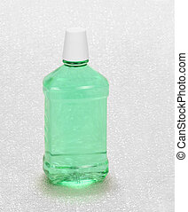 Mint Mouthwash - Bottle of mint green mouthwash on a...