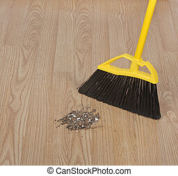 Sweeping Floor - Broom sweeping dirt on a hardwood floor