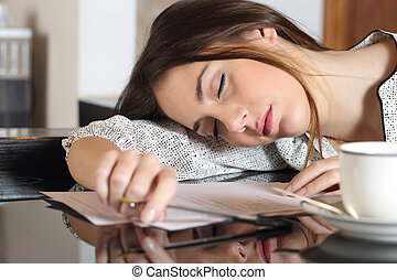 Tired overworked woman resting while writing notes - Tired...