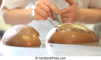 hands pastry chocolate easter eggs - hands pastry decorating...