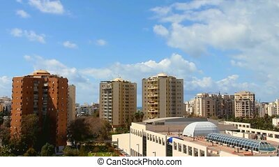 Clouds time lapse over Tel Aviv skyline at Sunny Day
