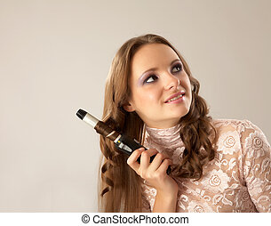 A smartening up girl - The beautiful girl does a wave of...