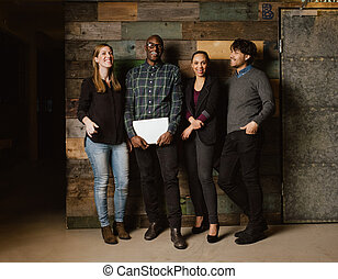 Multi ethnic business team looking happy together - Portrait...