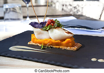 Gastronomic dish - Saint-Jacques scallops, carrots puree and...