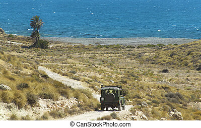Gravel road to the beach with four wheel drive in Spain...