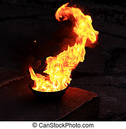 Bowl with fire on the stage, background