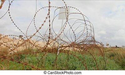 Barbed wire on the ground around the protected area