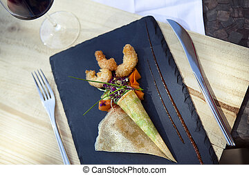 Gastronomic dish - Pancake with vegetables and prawn...