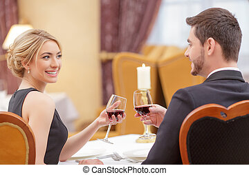 Attractive couple visiting luxury restaurant - Couple at the...