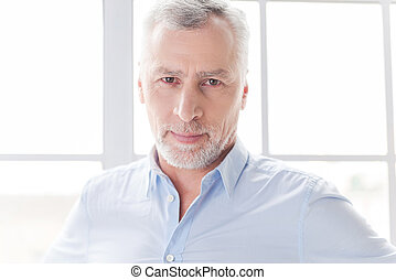 Confident and successful Confident grey hair senior man in...