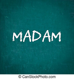 MADAM written on chalkboard