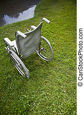 Wheelchair for disabled near a small lake