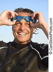 happy smiling man in wetsuit - a color portrait of a...