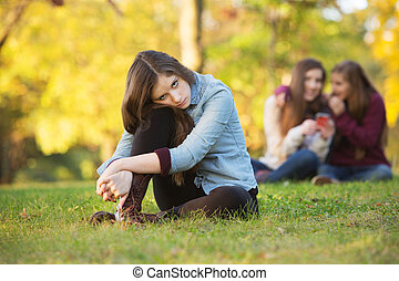 Teens Talking About Girl - Lonely girl leaning on knee in...