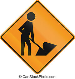 Workers In Road Ahead - US traffic warning sign: Workers in...