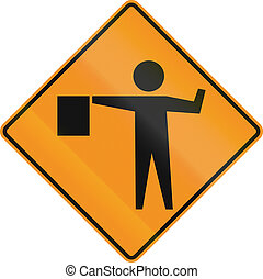 Flaggers In Road Ahead - US warning traffic sign: Flaggers...