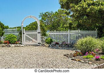 The Garden Gate - A sunny garden with sandy soil on Long...