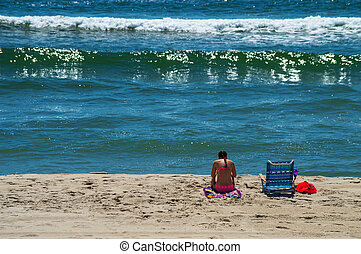 Quiet Time on the Beach - A girl enjoys quiet time on the...