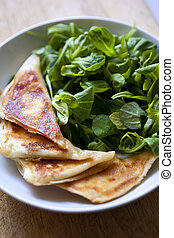 Pancakes - Cheese pancakes and green salad on a plate