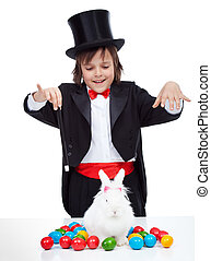 Young magician boy performing an easter trick - conjuring a...