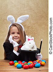 Young magician after successfully conjuring an easter rabbit...