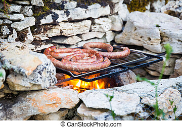 Fresh sausage grilling on a barbeque - Fresh beef sausage...