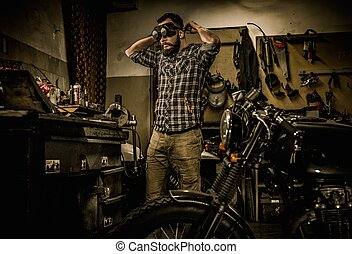 Mechanic preparing ford lathe works in motorcycle customs...