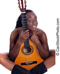 Young black woman implied nude behind guitar