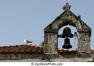A seagull sitting on a roof