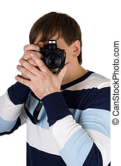 Young man with a camera. Isolated on white