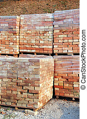 Building materials - stacks of packed bricks outdoor,...