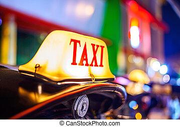 Thai Taxi Tuk Tuk sign with defocused lights blur , Chiang...