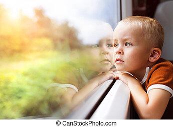 Little boy travelling in train - Little boy traveling in...