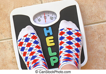 Womans feet on bathroom scale Diet concept