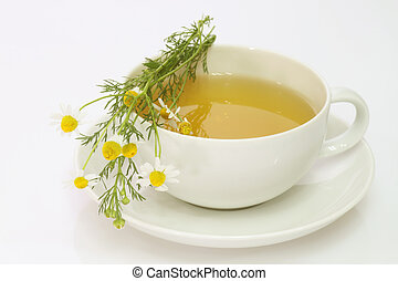 Camomile tea - Herbal camomile tea on bright background