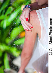 Young girl in tropical shower during beach vacaion - Young...