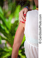 Young woman in tropical shower on exotic resort during beach...