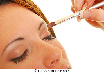 In make-up - Attractive Caucasian woman having make-up...