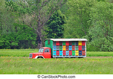 Mobile apiary - Photo of mobile apiary parked in a field