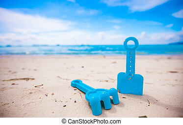 Summer kid's beach toys in the white sandy beach - Summer...
