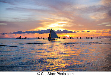 Sailing boat at beautiful colorful sunset - Sailing boat to...