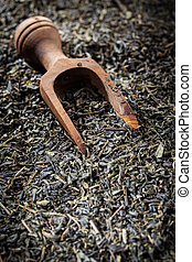 Dry tea - Dry green tea as a background