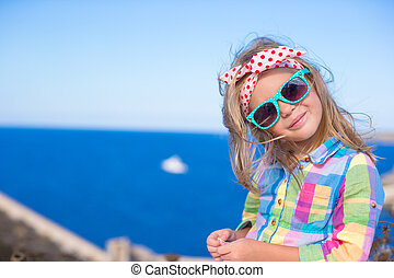 Adorable little girl have fun outdoor, Corsica