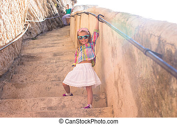 Adorable little girl outdoors in European city - Adorable...